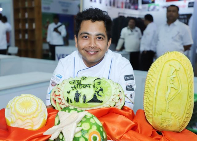 New Delhi: Chef Jitender shows his art work on a watermelon during 14th 'Culinary Art India 2019' at Pragati Maidan in New Delhi, on March 12, 2019. (Photo: IANS) by .