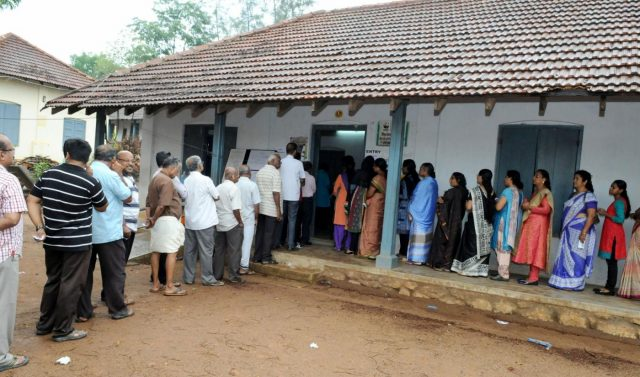 Trivandrum: Voters queue-up to cast their votes at a polling booth, during the Kerala Assembly Election, in Trivandrum district, Kerala on May 16, 2016. (Photo: IANS/PIB) by .