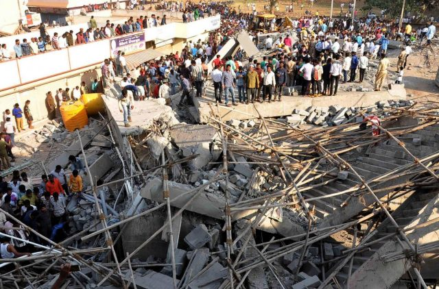 Dharwad: Rescue operations underway after an under construction multi-storey building collapsed leaving two people dead and 50 others trapped in Karnataka's Dharwad on March 19, 2019. (Photo: IANS) by .