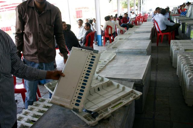 Poll personnel inspect electronic voting machine before dispatching it to different polling stations in Bhopal on April 3, 2014. (Photo: IANS) by .