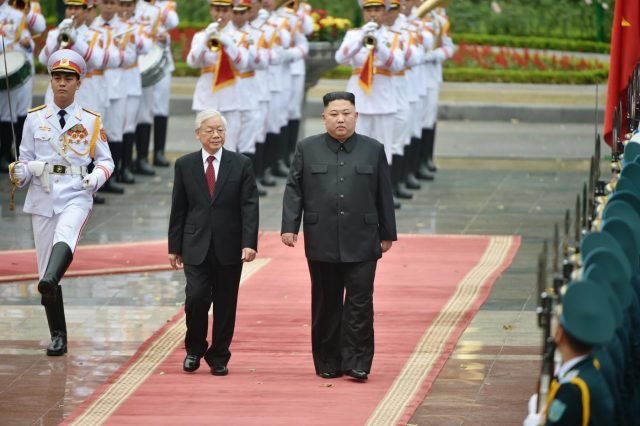 HANOI, March 2, 2019 (Xinhua) -- General Secretary of the Communist Party of Vietnam Central Committee and President Nguyen Phu Trong, and Chairman of the Workers' Party of Korea and the State Affairs Commission of the Democratic People's Republic of Korea (DPRK) Kim Jong Un, inspect the guard of honor during a welcoming ceremony in Hanoi, Vietnam, March 1, 2019. Kim paid an official visit to Vietnam on Friday and Saturday. (Xinhua/Wang Shen/IANS) by .