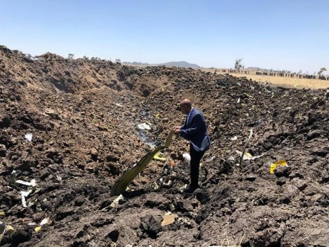 ADDIS ABABA, March 10, 2019 (Xinhua) -- A man checks the wreckage of the airplane of Ethiopian Airlines (ET) which crashed earlier near Bishoftu city, about 45 kms southeast of Addis Ababa, Ethiopia, March 10, 2019. All 149 passengers and eight crew members aboard ET 302, bound for Nairobi, Kenya, are confirmed killed, the Ethiopian Broadcasting Corporation (EBC) said. (Xinhua/Ethiopian Airlines/IANS) by .