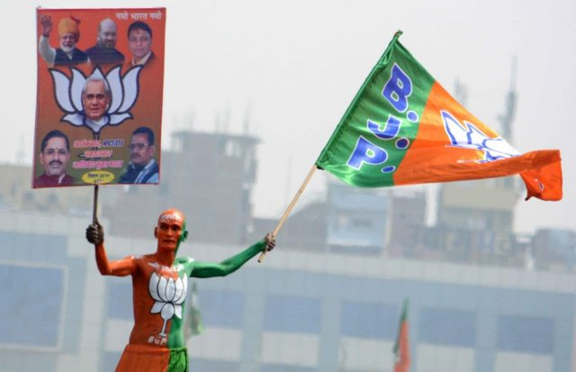 Patna: BJP supporter at Prime Minister Narendra Modi's 'Sankalp Rally' in Patna, on March 3, 2019. (Photo: IANS) by .