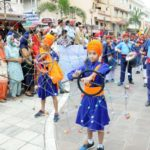 Amritsar: Sikh Nihangs perform 'Gatka' during a procession taken out to mark the 100th anniversary of the 1919 Jallianwala Bagh massacre, in Amritsar on April 12, 2019. (Photo: IANS) by .