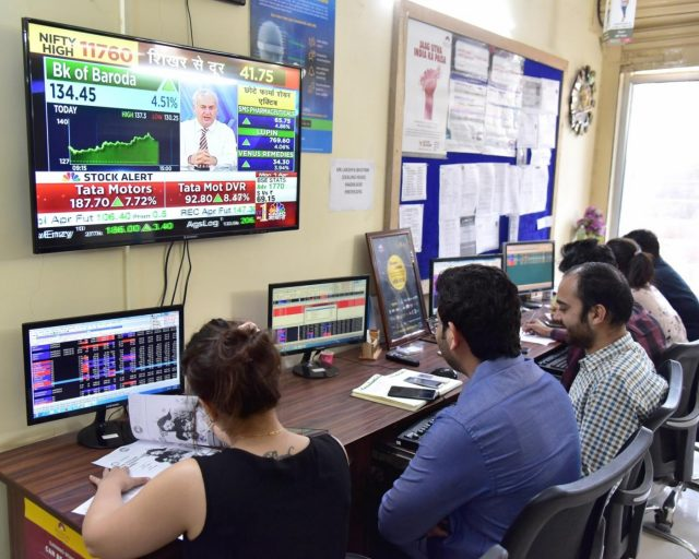 Bikaner: Stock traders monitor share prices in Bikaner, on April 1, 2019. The BSE Sensex on Monday touched a record high and crossed the 39,000 mark for the first time. Around 10.15 a.m., the Sensex hit a fresh record of 38,993 points. (Photo: IANS) by .
