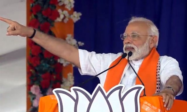 Songadh: Prime Minister Narendra Modi addresses a public rally in Gujarat's Songadh, on April 10, 2019. (Photo: IANS) by .