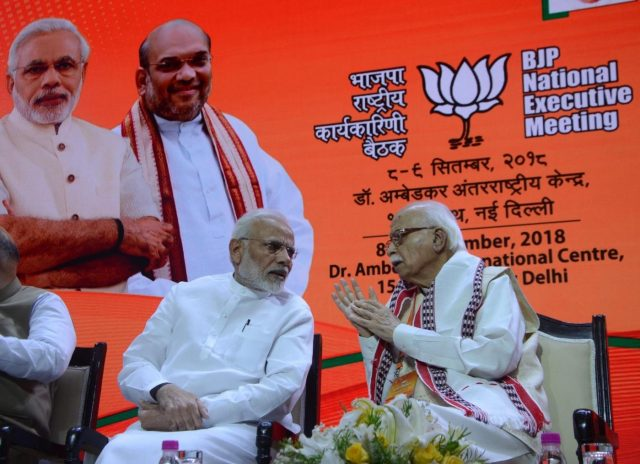 New Delhi: Prime Minister Narendra Modi interacts with BJP senior party leader LK Advani during BJP's National Executive meeting, in New Delhi on Sept 8, 2018. (Photo: IANS) by .