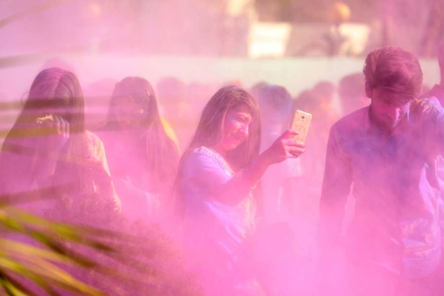 ISLAMABAD, March 10, 2019 (Xinhua) -- A girl takes a selfie during a color fight to celebrate spring in Islamabad, capital of Pakistan, on March 9, 2019. (Xinhua/Ahmad Kamal/IANS) by .