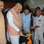 Varanasi: BJP President Amit Shah accompanied by Union Ministers Piyush Goyal and J.P. Nadda, lights the lamp to inaugurate BJP's office, in Varanasi, on April 24, 2019. (Photo: IANS) by .
