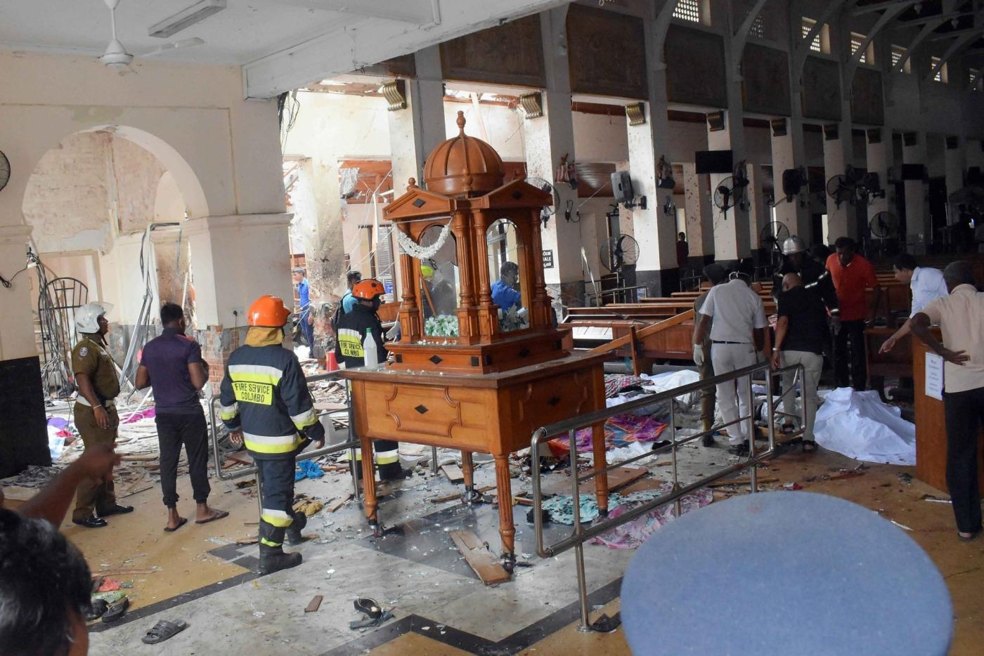 Colombo, April 22, 2019 (Xinhua) -- People work at a blast scene at St. Anthony's Church in Kochchikade in Colombo, Sri Lanka, April 21, 2019. The death toll from the multiple blasts that ripped through Sri Lanka on Sunday rose to 228 while 450 others were injured, local media quoting hospital sources said. (Xinhua/Wang Shen/IANS) by .