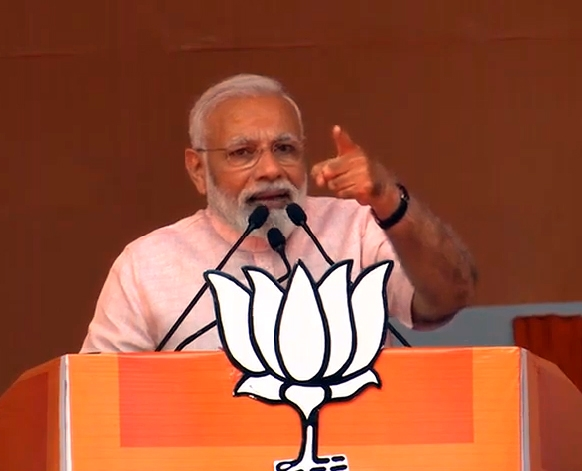 Amroha: Prime Minister and BJP leader Narendra Modi addresses a public rally ahead of 2019 Lok Sabha elections, in Uttar Pradesh's Amroha, on April 5, 2019. (Photo: IANS) by .