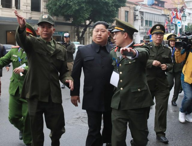 Hanoi: Police officers haul away an unidentified man impersonating North Korean leader Kim Jong-un near the venue for a two-day U.S.-North Korean summit in Hanoi on Feb. 27, 2019.(Yonhap/IANS) by .