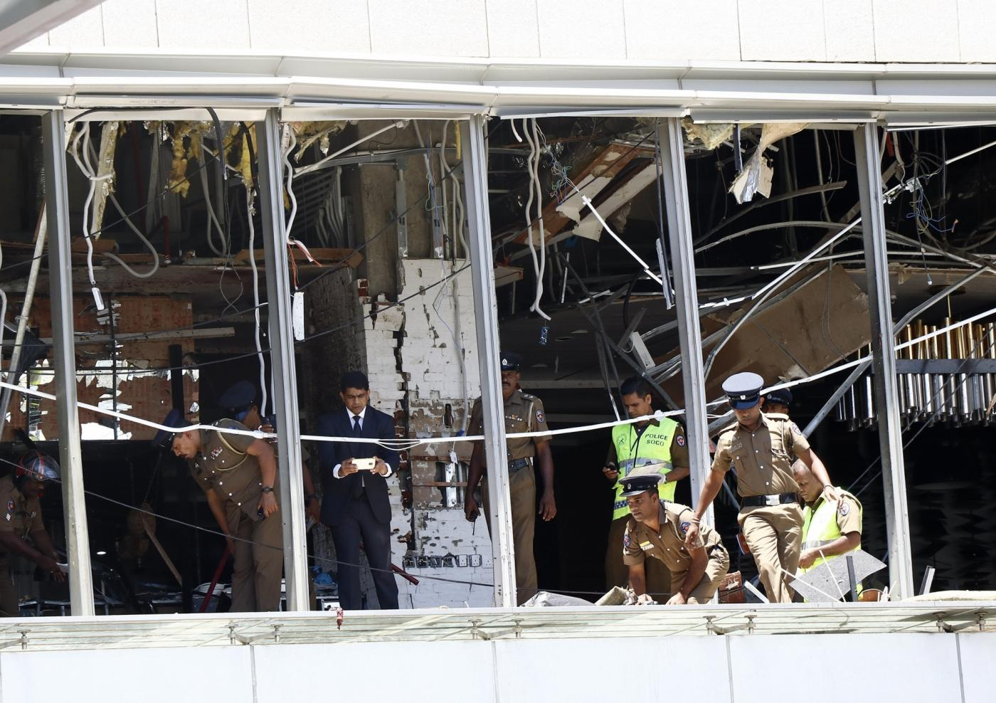 Colombo, April 22, 2019 (Xinhua) -- Police and investigators work at a blast scene at Shangri-La hotel in Colombo, Sri Lanka, April 21, 2019. The death toll from the multiple blasts that ripped through Sri Lanka on Sunday rose to 228 while 450 others were injured, local media quoting hospital sources said. (Xinhua/Wang Shen/IANS) by .