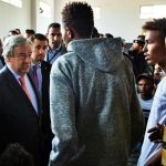 United Nations Secretary-General António Guterres speaks with a young man at the Ain Zara Detention Centre in Tripoli, Libya, where migrants and refugees are held. (Photo: UN/IANS) by .