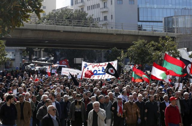 BEIRUT, Feb. 17, 2019 (Xinhua) -- Protesters hold flags and banners during a protest in Beirut, capital of Lebanon, Feb. 17, 2019. Hundreds of Lebanese on Sunday protested in capital Beirut's downtown against the new government and its policies, the National News Agency reported. (Xinhua/Bilal Jawich/IANS) by .