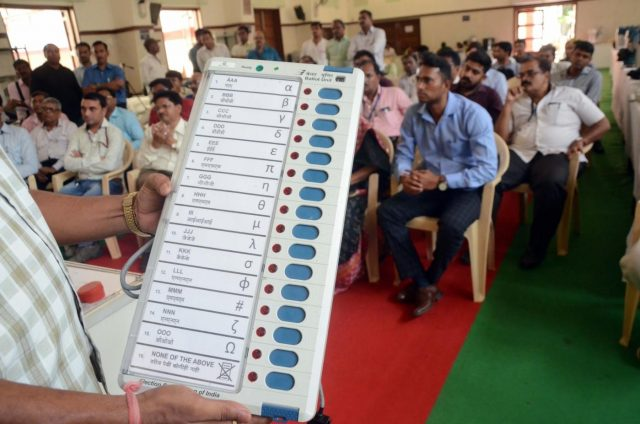 Mumbai: Election officials demonstrate the functioning of an Electronic Voting Machine (EVM) and Voter Verified Paper Audit Trail (VVPAT) ahead of 2019 Lok Sabha polls during a voter awareness programme in Mumbai, on April 10, 2019. (Photo: IANS) by .