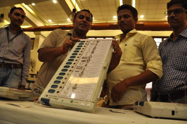 Mumbai: Polling officials check an Electronic Voting Machines (EVM) ahead of the 2019 Lok Sabha elections, at Dadar in Mumbai on April 22, 2019. (Photo: IANS) by .