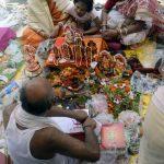 Kolkata: Devotees surround a priest performing rituals during Bengali New Year celebrations in Kolkata, on April 15, 2019. (Photo: Kuntal Chakrabarty/IANS) by .