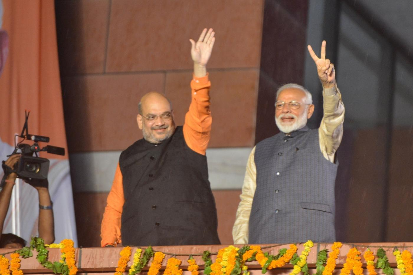 New Delhi: Prime Minister Narendra Modi and BJP chief Amit Shah wave at party workers during a party programme in New Delhi on May 23, 2019. (Photo: IANS) by .
