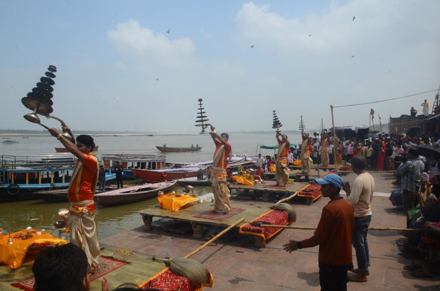 Varanasi: Priests performing daily Ganga aarti in the afternoon at Dashashwamedh Ghat in view of the lunar eclipse in Varanasi, on July 27, 2018. The Century's longest lunar eclipse or Chandra Grahan will be visible tonight form 10:44 pm tonight and it will end at 4:58 am on July 28. The total lunar eclipse duration will be 103 minutes or 1 hour 43 minutes long. (Photo: IANS) by .