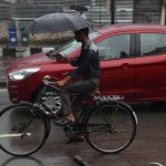 Guwahati: A man shields himself with an umbrella as he paddles thorough a wet street during rains, in Guwahati on May 3, 2019. Assam and some other parts of the Northeast have been witnessing light to moderate rains since Friday morning due to the impact of cyclonic storm Fani. Assam government has sounded an alert in all districts of the state following a warning that the cyclone will lash Assam and other parts of the northeastern region for two days starting Saturday early hours. (Photo: IANS) by .