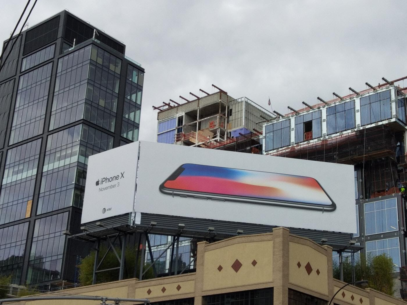 New York: A hoarding of Apple iPhone X smartphone on display in New York on Oct 23, 2017. (Photo: IANS) by .