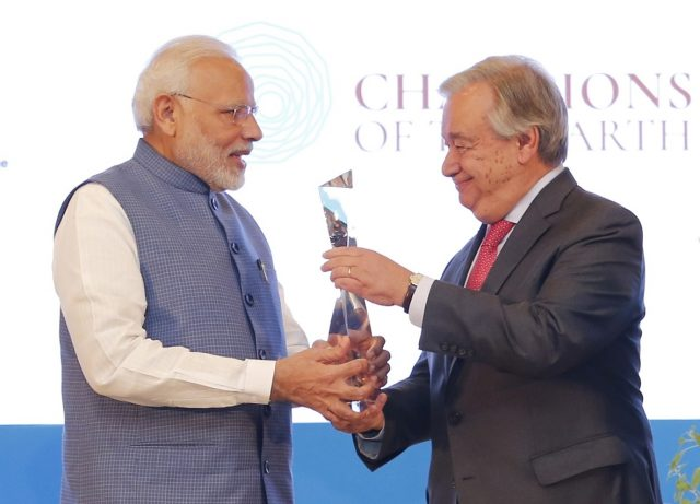 United Nations Secretary-General António Guterres presents Prime Minister Narendra Modi with the Champion of Earth award, the highest environmental honour of the UN, in New Delhi on October 3, 2018. (Photo: UN/IANS) by .
