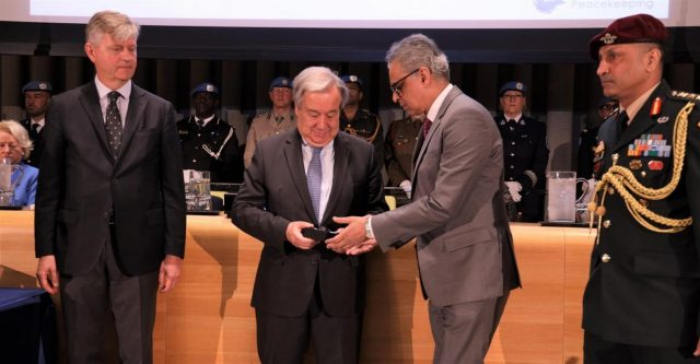 United Nations Secretary-General Antonio Guterres presents to India's Permanent Representative Syed Akbaruddin, right, the Dag Hammarksjold Medal honouring Indian peacekeeper Jitender Kumar, a police officer who laid down his life while serving the UN Organization Stabilization Mission in the Democratic Republic of the Congo (MONUSCO). At left is Jean-Pierre Lacroix, the Under-Secretary-General for Peace Operations. (Photo: Indian Mission/IANS) by .