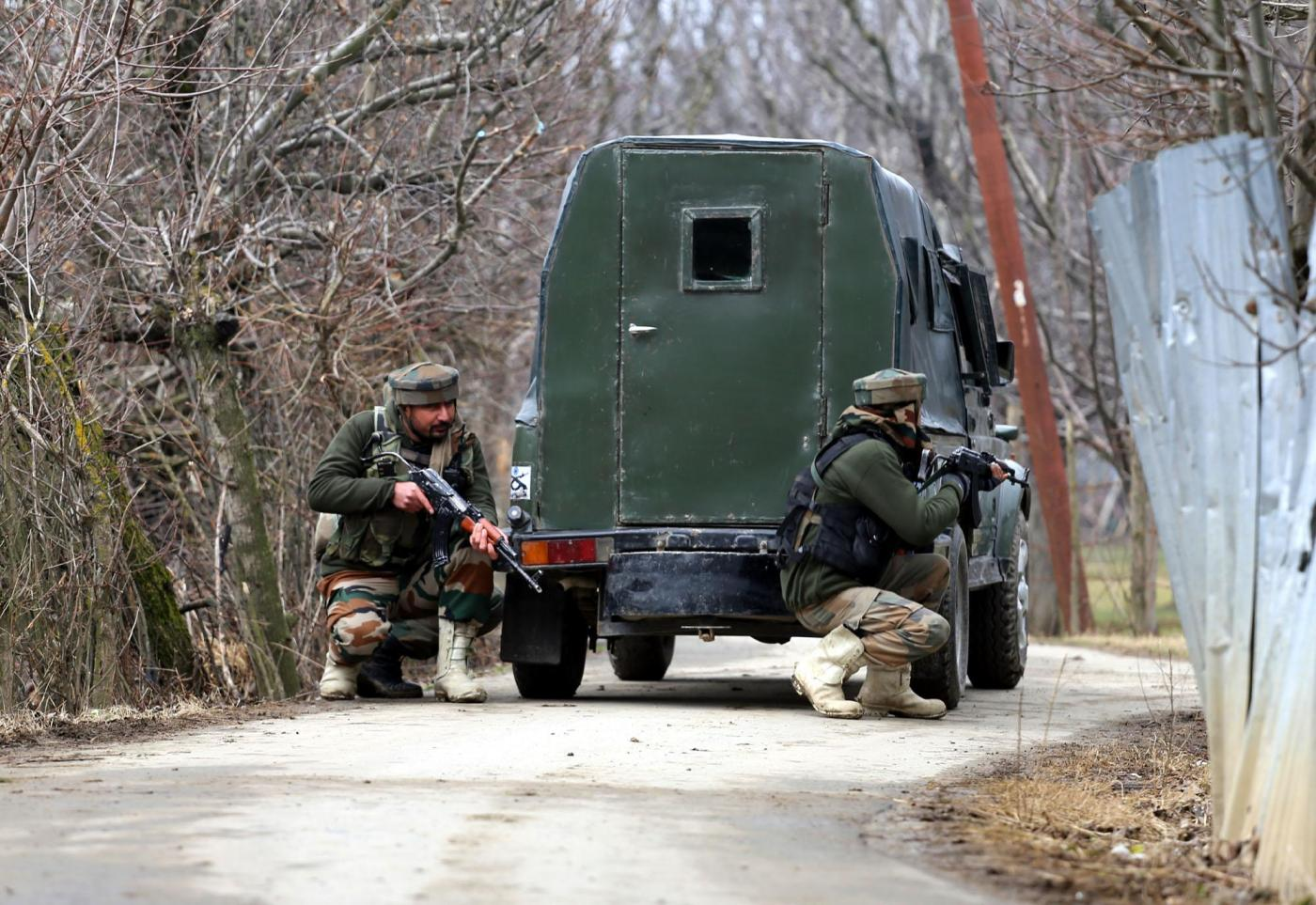Sopore: Soldiers take position during a gun-battle with militants at Rehmatabad village in Jammu and Kashmir's Sopore district on Feb 21, 2015. Two foreign guerrillas belonging to the Lashkar-e-Taiba (LeT) group were killed in the encounter. (Photo: IANS) by .