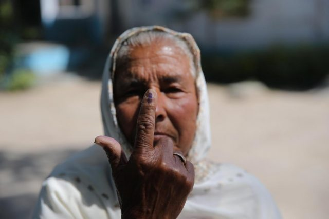 Amritsar: An elderly lady shows her forefinger marked with indelible ink after casting vote during the seventh and the last phase of 2019 Lok Sabha Elections at a polling booth in Amritsar on May 19, 2019. (Photo: IANS) by .
