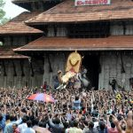 """Thrissur: Elephant """"Thechikottukavu Ramachandran"""" opens the door of the southern gopuram of the Vadakkumnathan temple to formally announce the beginning of the Thrissur Pooram in Kerala's Thrissur on May 4, 2017. (Photo: IANS) by ."""