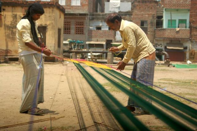 Weavers weave sarees even on International Workers' Day which is celebrated worldwide on 1st May to commemorate the historic struggle of workers for their rights, in Varanasi on May 1, 2014. (Photo: IANS) by .