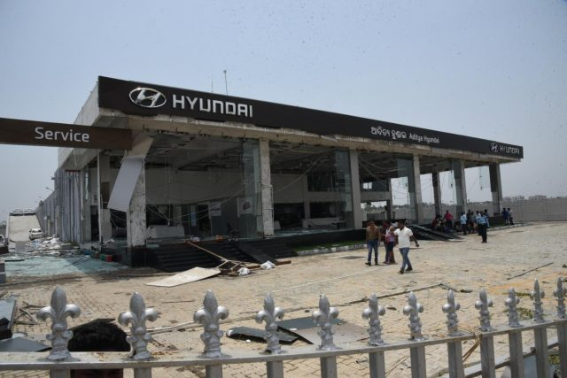 Bhubaneswar: A view of a damaged automobile showroom after extremely severe cyclonic storm Fani hit the coastal state of Odisha on Friday wreaking havoc in several parts of the state; in Bhubaneswar on May 6, 2019. (Photo: IANS) by .