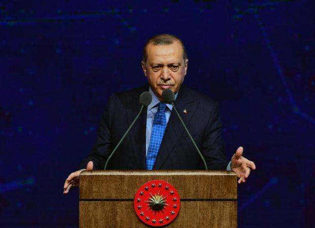 ANKARA, Dec. 13, 2018 (Xinhua) -- Turkish President Recep Tayyip Erdogan delivers a speech during the Turkish Defense Industry Summit in Ankara, Turkey, on Dec. 12, 2018. Turkey will launch a military operation in the east of Euphrates River in Syria in a few days, Turkish President Recep Tayyip Erdogan said on Wednesday. (Xinhua/Mustafa Kaya/IANS) by .