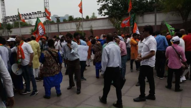 New Delhi: BJP supporters seen celebrating at the party's headquarters after the counting trends show that the party appeared set to retain power as its candidates led in most of the 542 Lok Sabha constituencies, in New Delhi on May 23, 2019. (Photo: IANS) by .