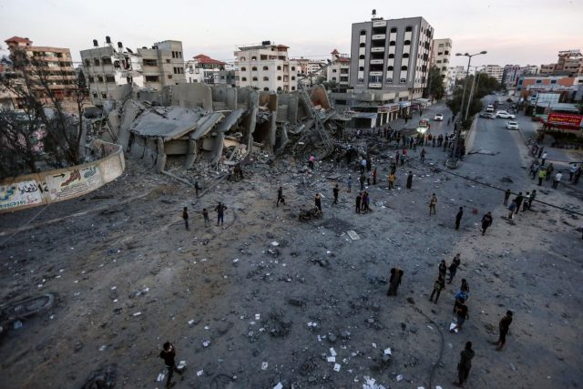 GAZA, May 5, 2019 (Xinhua) -- Palestinians inspect the remains of a building that was destroyed during Israeli airstrikes on Gaza City, on May 5, 2019. At least 20 Palestinians, including two infants and two pregnant women, have been killed in intensive Israeli airstrikes on the Gaza Strip since Saturday evening. (Xinhua/IANS) by .