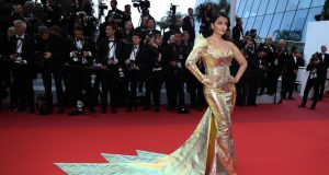 """CANNES, May 20, 2019 (Xinhua) -- Actress Aishwarya Rai Bachchan poses for photos upon her arrival at the premiere of the film """"A Hidden Life"""" at the 72nd Cannes Film Festival in Cannes, southern France, on May 19, 2019. The 72nd Cannes Film Festival is held from May 14 to 25. (Xinhua/Zhang Cheng/IANS) by ."""