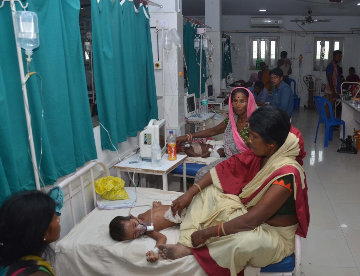 Muzaffarpur: Children with Acute Encephalitis Syndrome (AES) symptoms being treated at hospital in Muzaffarpur, Bihar on June 19, 2019. (Photo: IANS) by .