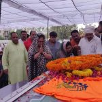 Jaipur: BJP workers pays tributes to state BJP chief Madan Lal Saini at the party state headquarters, in Jaipur on June 25, 2019. Saini, who was admitted at the All India Institute of Medical Sciences in New Delhi last week after a lung infection, died on Monday. He was 75. (Photo: IANS) by .