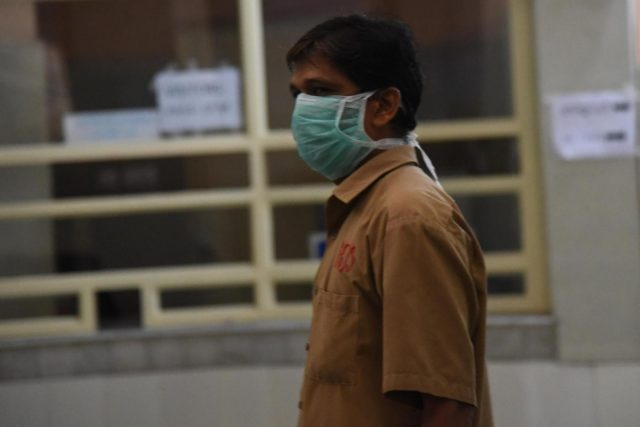Kochi: A hospital staff seen wearing mask as a precautionary measure against the Nipah virus (NIV) at Ernakulam General Hospital, in Kochi, on June 5, 2019. (Photo: IANS) by .
