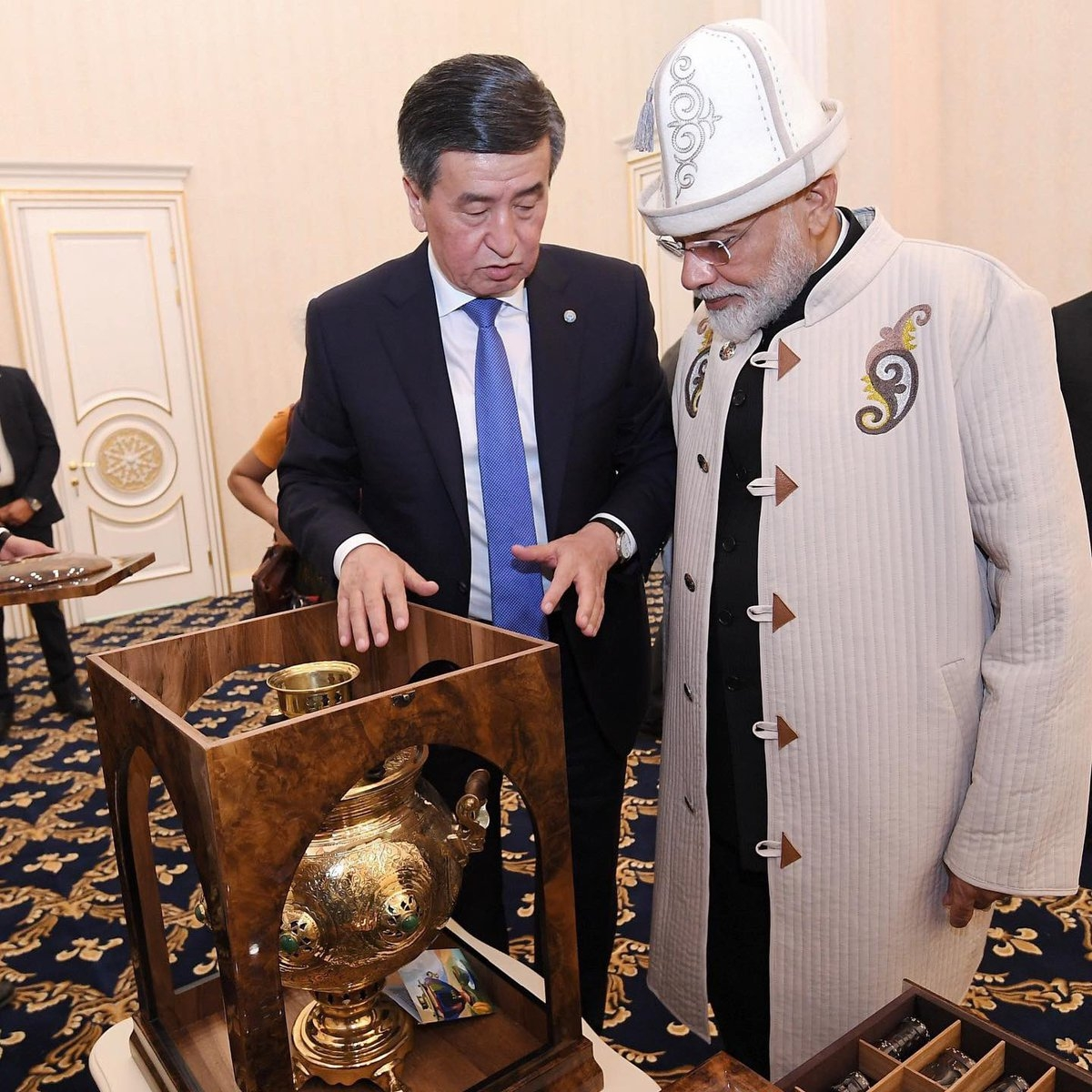 Bishkek: Kyrgyzstan President Sooronbay Jeenbekov presents a Kalpak, the traditional Kyrgyz hat, a Chapan a traditional coat from Kyrgyzstan and a Samovar a container to heat or boil water to Prime Minister Narendra Modi in Bishkek, on June 15, 2019. (Photo: IANS/@PMOIndia) by .