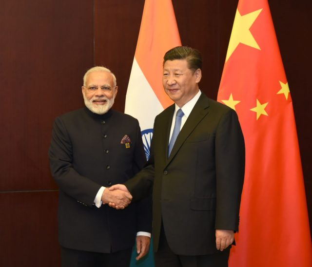 Kazakhstan (Astana): Prime Minister Narendra Modi meets the President of the People`s Republic of China, Xi Jinping, on the sidelines of the SCO Summit, in Astana, Kazakhstan on June 09, 2017. (Photo: IANS/PIB) by .
