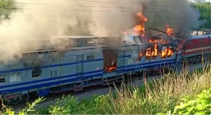 Rayagada: The Howrah-Jagadalpur Samaleshwari Express' the engine of which caught fire after the train rammed into a tower car engaged in repair work between Singapur Road and Keutguda in Odisha's Rayagada district on June 25, 2019. Suresh, a technician with the railways, was killed in the incident. (Photo: IANS) by .