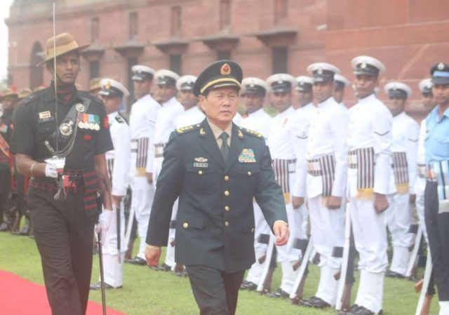 New Delhi: China's Defence Minister Gen. Wei Fenghe observes the Tri-Services Guard of Honour on his arrival at the South Block, in New Delhi on Aug 23, 2018. (Photo: IANS) by .