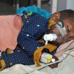 Muzaffarpur: A child with Acute Encephalitis Syndrome (AES) symptoms being treated at hospital in Muzaffarpur, Bihar on June 19, 2019. (Photo: IANS) by .