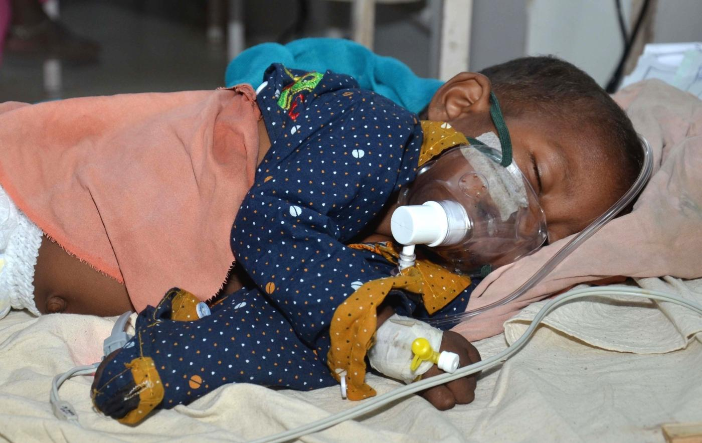 Muzaffarpur: A child with Acute Encephalitis Syndrome (AES) symptoms being treated at hospital in Muzaffarpur, Bihar on June 19, 2019. (Photo: IANS) by .