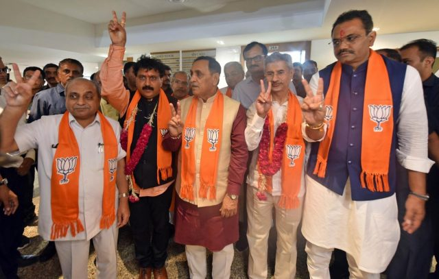 Gandhinagar: External Affairs Minister S. Jaishankar and BJP's Gujarat OBC Cell President Jugalji Thakor accompanied by Gujarat Chief Minister Vijay Rupani, Deputy Chief Minister Nitinbhai Patel and Gujarat BJP President Jitu Vaghani, show victory sign after filing their nominations for the July 5 bypoll for the two Rajya Sabha seats from Gujarat, in Gandhinagar on June 25, 2019. (Photo: IANS) by .