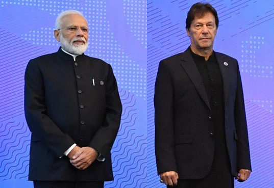 Prime Minister Narendra Modi and Pakistan Prime Minister Imran Khan at the SCO (Shanghai Cooperation Organisation) Council of Heads of State Meeting in Bishkek, Kyrgyzstan on June 14, 2019. (File Photo: IANS) by .