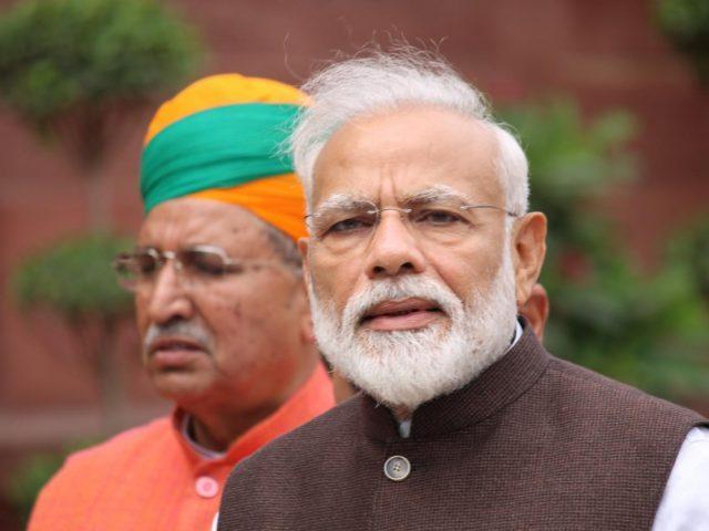 New Delhi: New Delhi: Prime Minister Narendra Modi arrives at Parliament house, in New Delhi on June 17, 2019. Also seen Union Minister Arjun Ram Meghwal. (Photo: Amlan Paliwal/IANS) by .