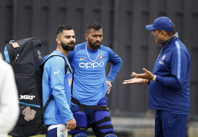 Southampton: India's captain Virat Kohli and coach Ravi Shastri with Hardik Pandya during a practice session ahead of a World Cup 2019 match against Afghanistan at the Hampshire Bowl in Southampton, England on June 19, 2019. (Photo: Surjeet Yadav/IANS) by .